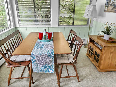 Dining table on the porch seats 4-25 Zylpha Rd Harwich Port- Cape Cod- New England Vacation Rentals