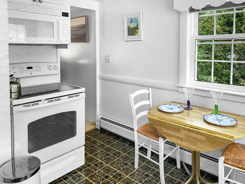 Kitchen with drop leaf table, stove and microwave-25 Zylpha Rd Harwich Port- Cape Cod- New England Vacation Rentals