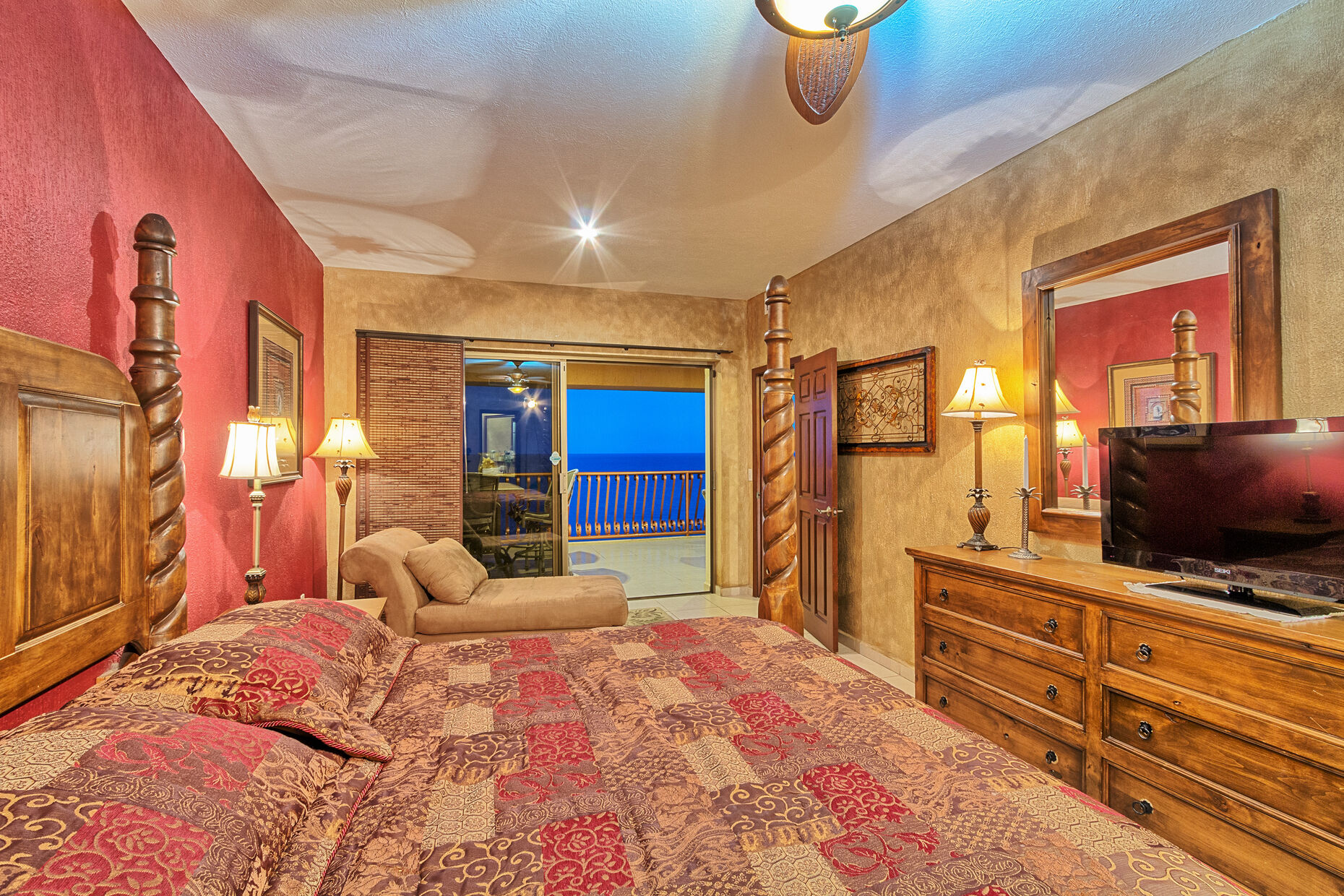 Master bedroom with view of the sea and entrance to patio