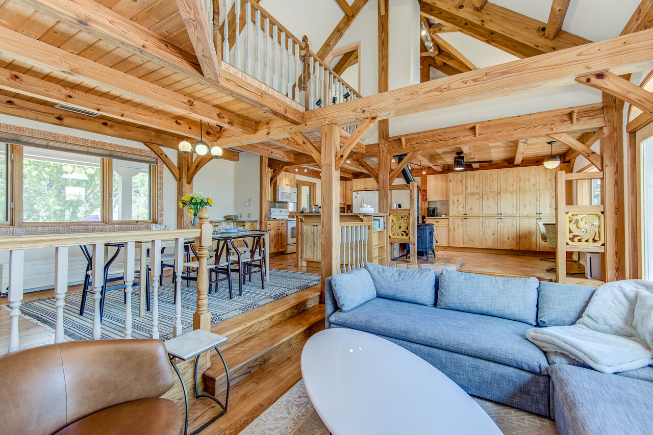 Open Floor Plan with Vaulted Wood Beam Ceilings and a Sunken Living Room