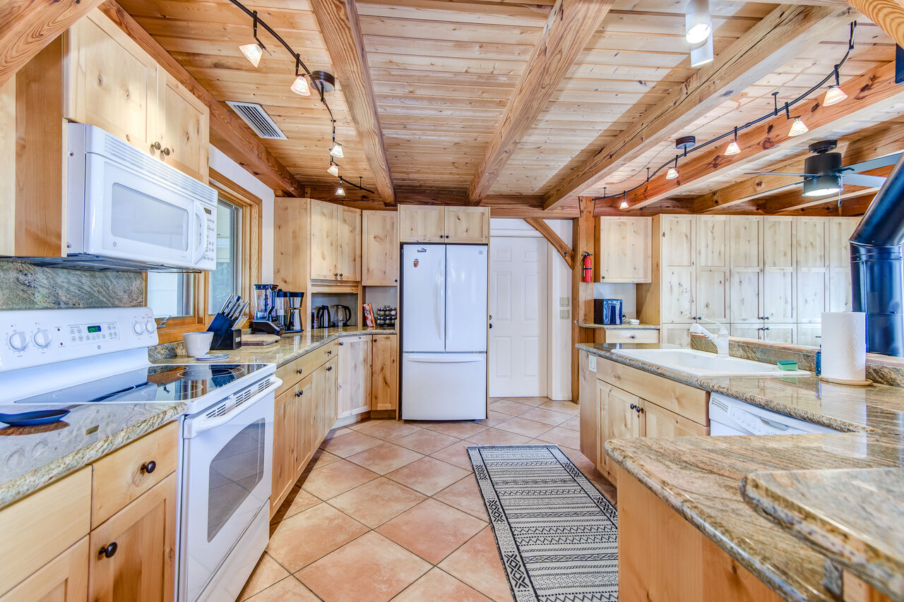 Plenty of Stone Counter Space for Meal Prep and Entertaining