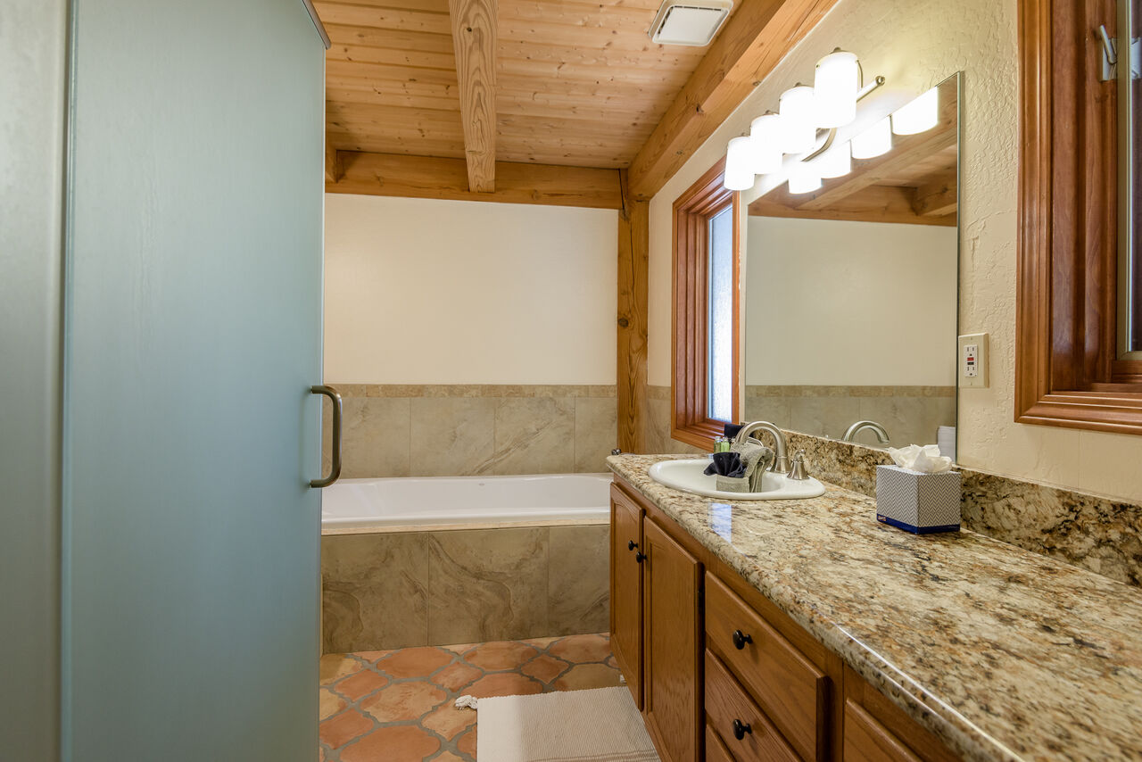 Main Level Full Shared Bath with a Soaking Tub and Separate Shower