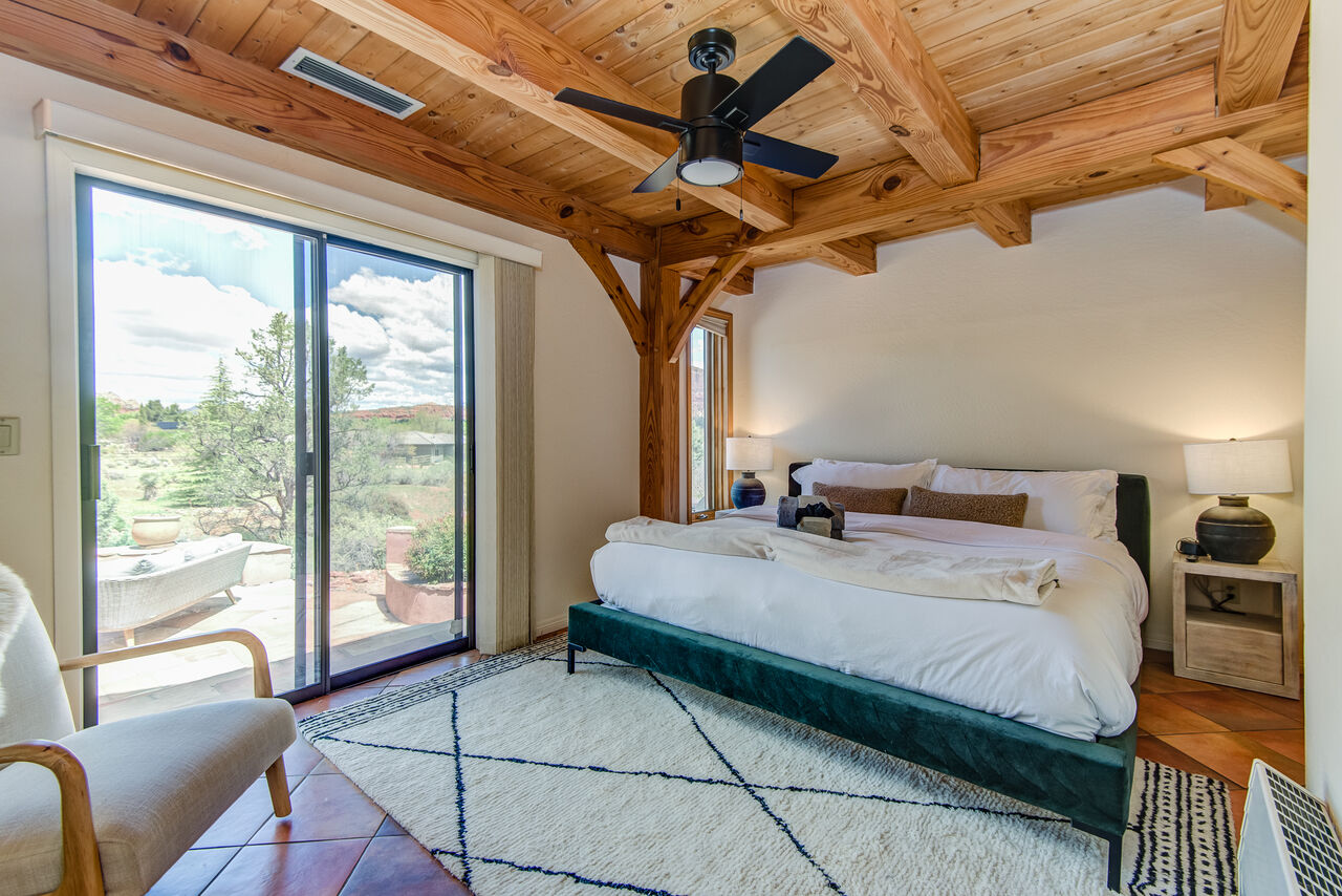 Main Level Bedroom 3 with a King Bed and Patio Access