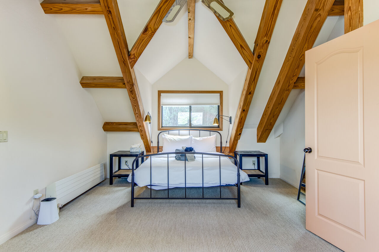 Upper Level Master Bedroom 2 with a Queen Bed and Vaulted Ceiling