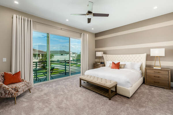 Lay your head back and sleep soundly in this Master Suite, featuring a king-size bed and balcony access