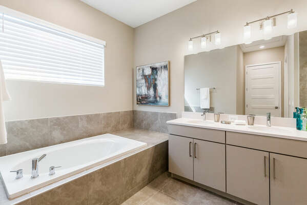 The Master Suite has an ensuite bathroom with a garden tub