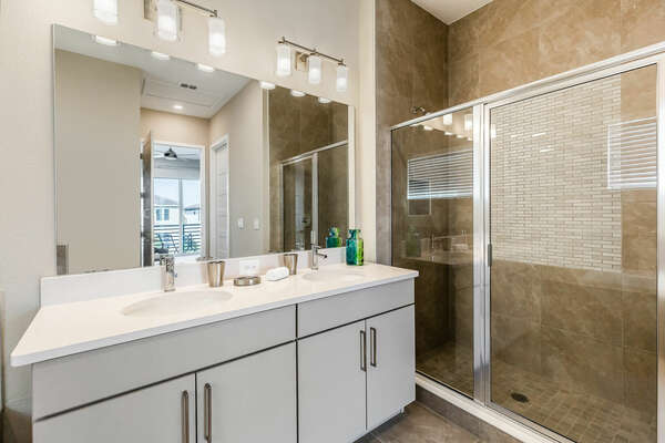 Along with the garden tub is a dual vanity and walk-in shower