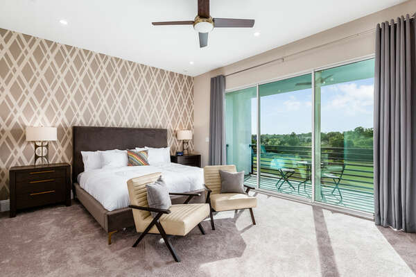 This Master Suite features a king-size bed with balcony access