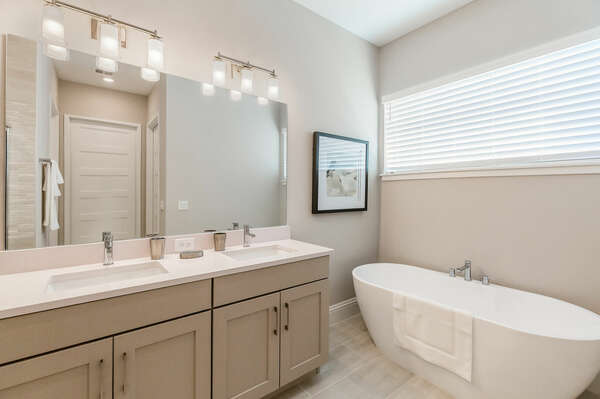 The Master ensuite bathroom features a dual vanity, walk-in shower, and garden tub