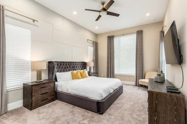 Unwind in this Master Suite featuring a king-size bed