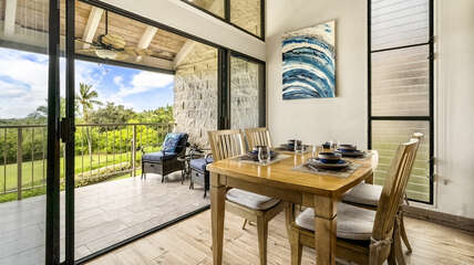 Dining table for four next to large walk-out lanai