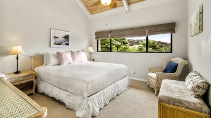 Bedroom with large bed and sitting area