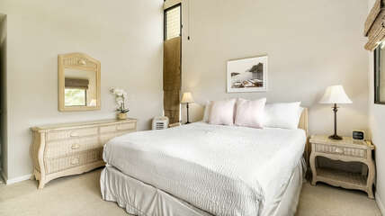 Main bedroom with large bed and matching bedroom furniture