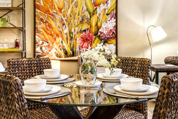 Dining Table with Settings and Woven Seats at Waikoloa Hawaii Vacation Rentals