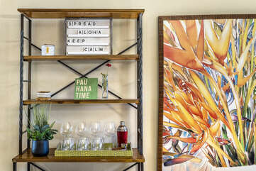 Floral Painting and Shelf with Wine Glasses and Shaker