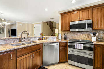 Kitchen with Wrap around Counters and Wooden Cabinets