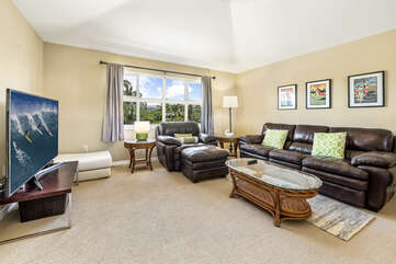Loft Seating Area with Leather Sofas and Flat-Screen TV at Waikoloa Hawaii Vacation Rentals
