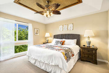 Main Bedroom with a King Bed and Views of the Tropical Fauna