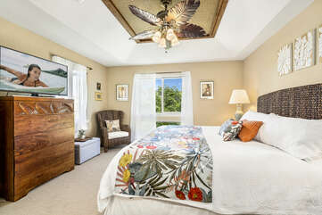 Bedroom with TV, Ceiling Fan, and King Bed at Waikoloa Hawaii Vacation Rentals