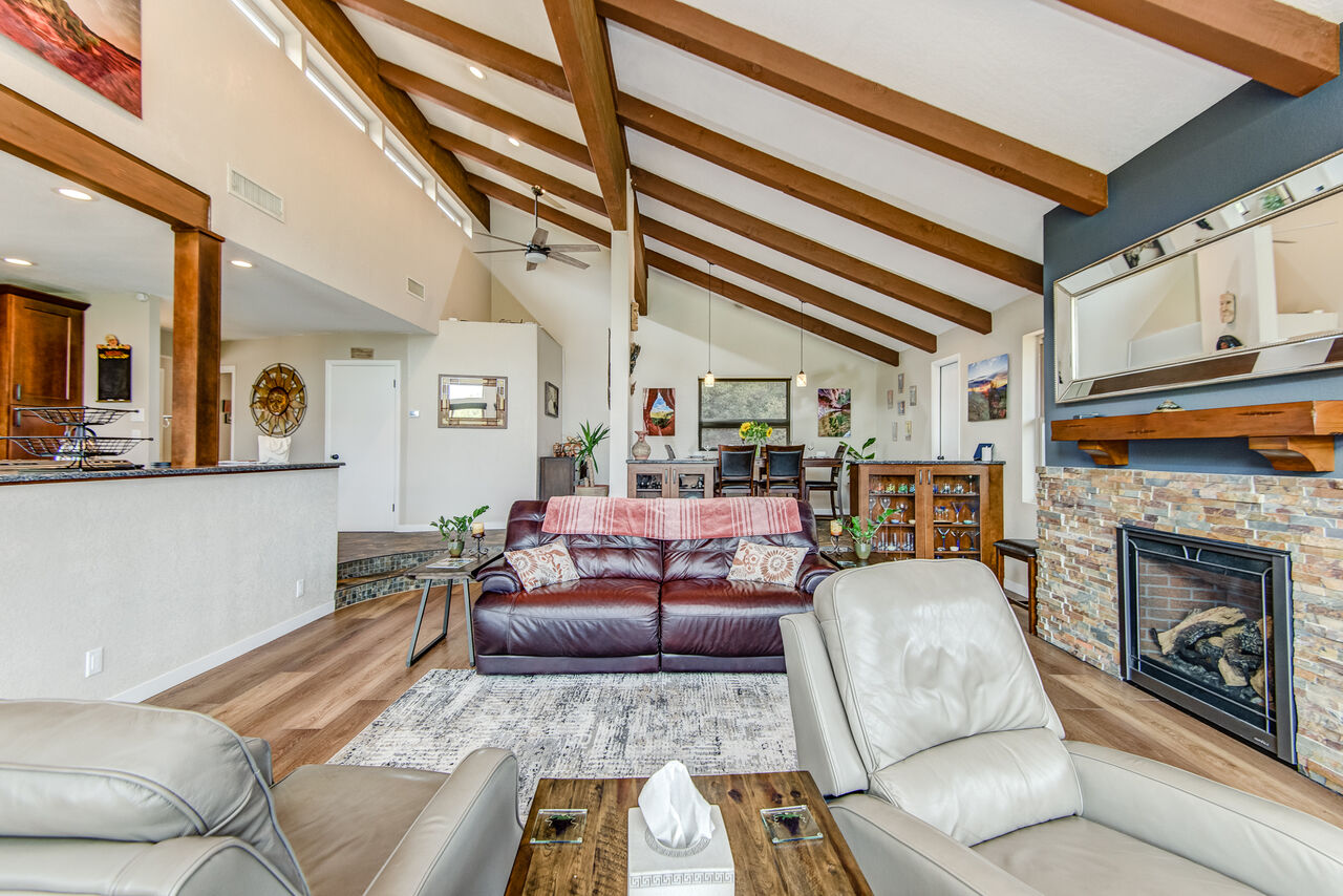 Living Room with Wood Flooring and Wood Beam Ceiling