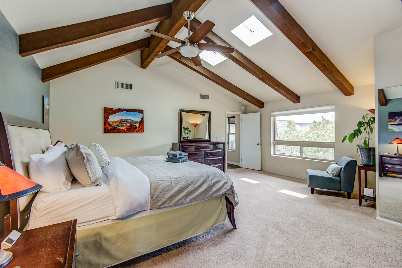 Master Bedroom with a Vaulted Ceiling and Sky Lights
