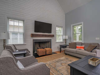 The open floor plan for this home has cathedral ceilings, ship lap walls, and plenty of light.