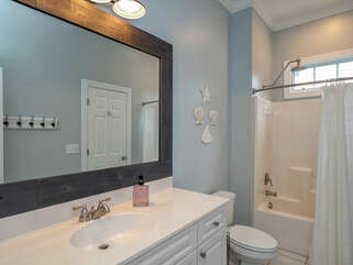 Master bath has a vanity and shower/tub combo