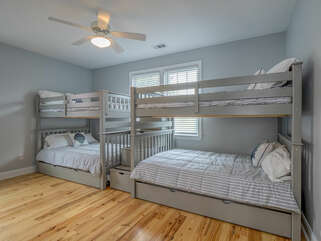 The kid's space! Two sets of full bunks with two trundles.  Sleeping for plenty.