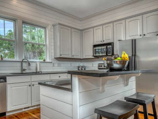 This open kitchen invites the pickiest chef.  A breakfast island is the perfect meal prep spot and has two counter stools
