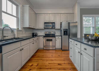 Stainless appliances, black granite counters and both Keurig and drip coffee makers