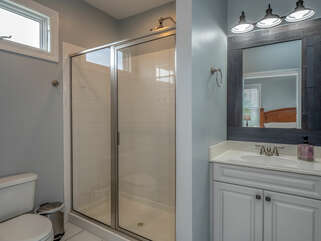 The private bath with shower and vanity