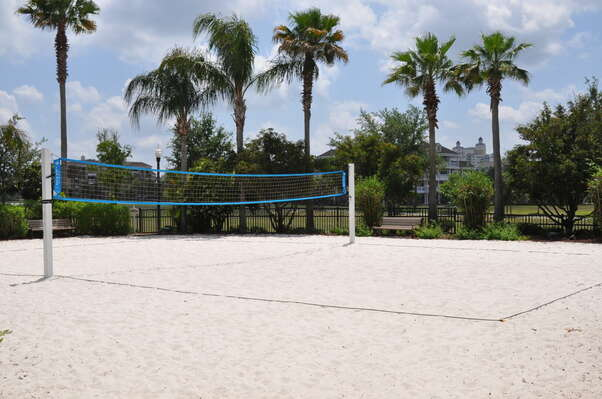 Play a game of beach volleyball