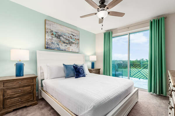 Master suite with a king-size bed and balcony access
