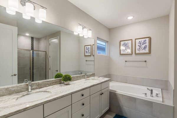 Ensuite bathroom with dual vanity and garden tub