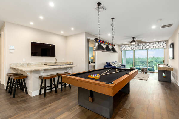 Play a game of billiards at the upstairs loft