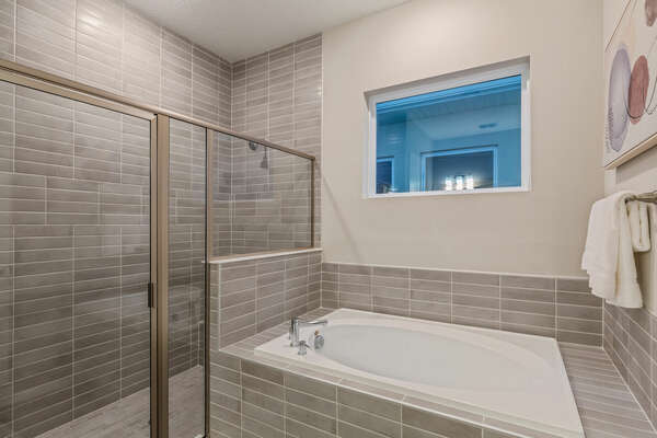 The Walk-in shower and garden tub are in the ensuite bathroom