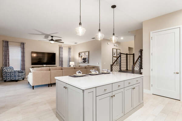 The open floor plan allows families to connect wherever they are in the house