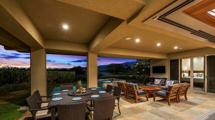 expansive lanai, complete with a dining table, and large seating area