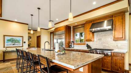 kitchen is equipped with Subzero, Wolf, and Bosch appliances