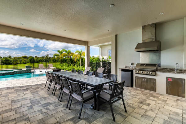 Dine al fresco at the outdoor dining table with seating for 12