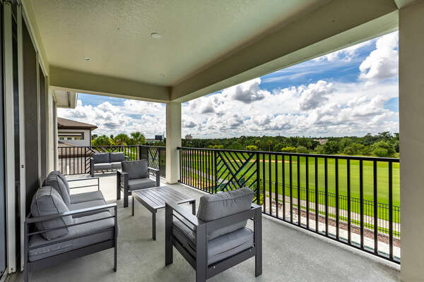 Take in the view of the golf course outside on the back balcony