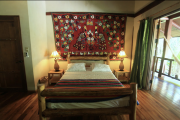 Bedroom 5, with a queen-size bed, and access to the balcony