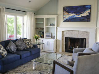 HD Smart TV surrounded by book shelves and a fire place