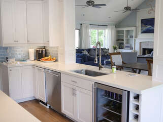 Quartz countertops and stainless steel appliances are in the gourmet kitchen