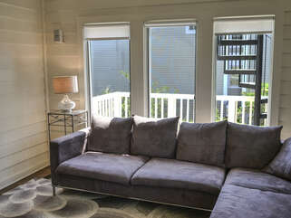 Off the kitchen is the study/sunroom with large sectional sofa