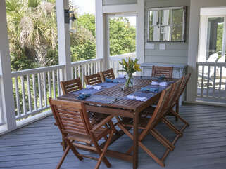 Head out to the screened porch. Al fresco dining for 10 at the large dining table