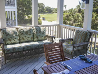 A perfect spot on the screen porch for your morning cup of coffee or an hour spent on your perfect beach read!