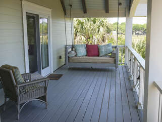 The front porch has two separate seating areas
