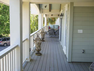 The porch stretches the width of this beautiful beach home