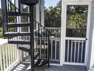 Spiral staircase from the screen porch to the roof deck